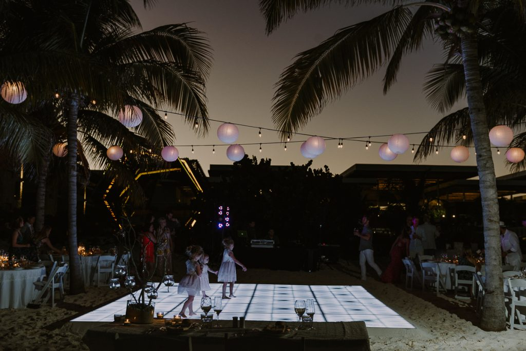 Beach wedding reception with lighted dance floor at Royalton Riviera Cancun, Mexico. Caro Navarro Photography