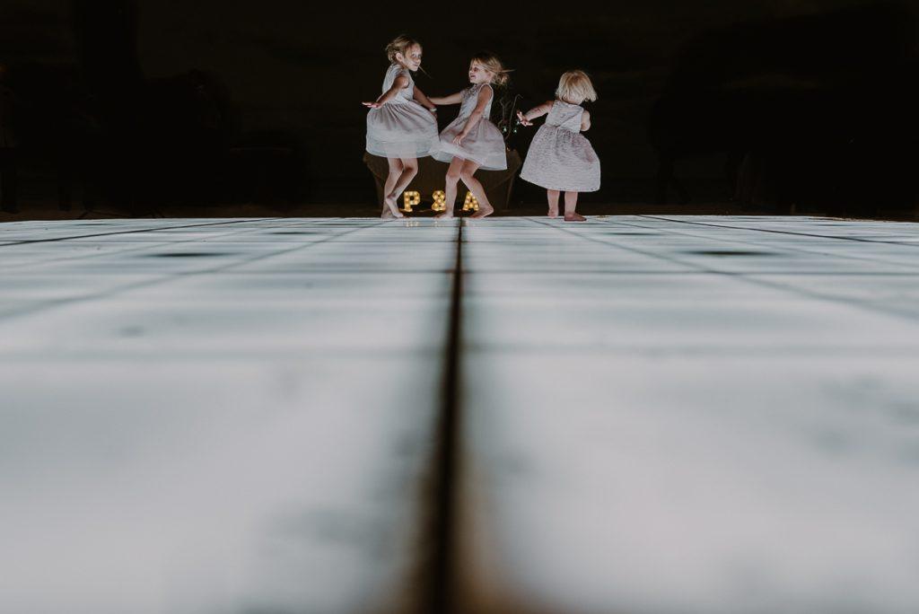 Flower girls dancing at Royalton Riviera Cancun wedding reception, Mexico