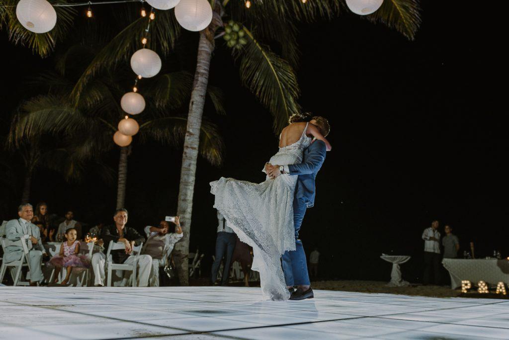 Bride and groom first dance under bistro lights. Royalton Riviera Cancun reception. Caro Navarro Photography