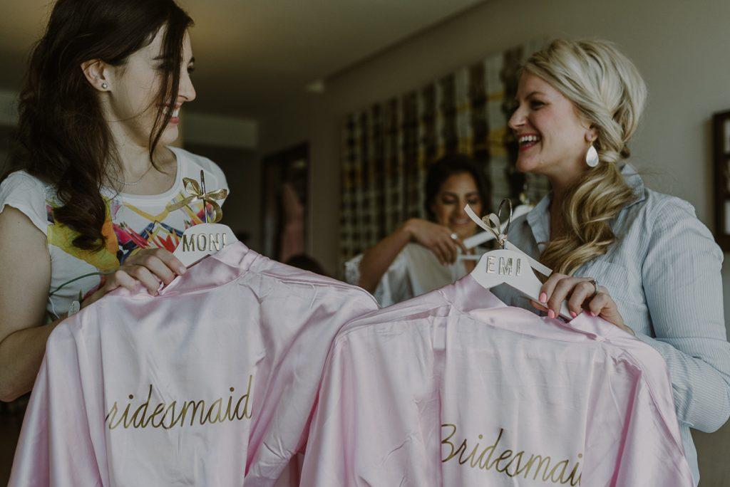 Pink bridesmaids robes at a Royalton Riviera Cancun Wedding. Caro Navarro Photography