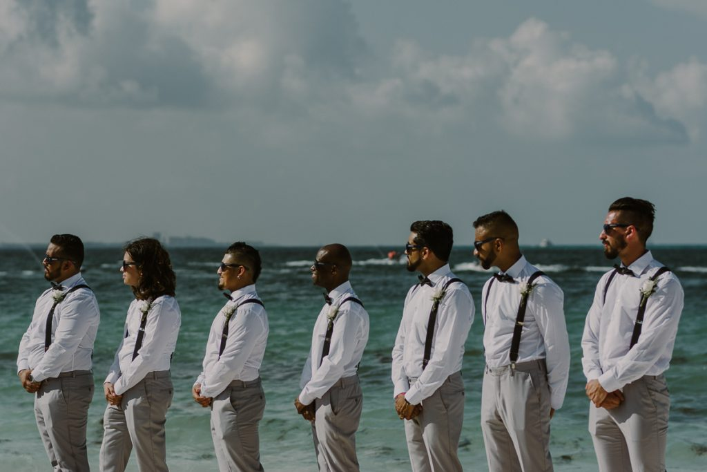 Groomsmen at Riu Caribe Cancun beach wedding by Caro Navarro Photography