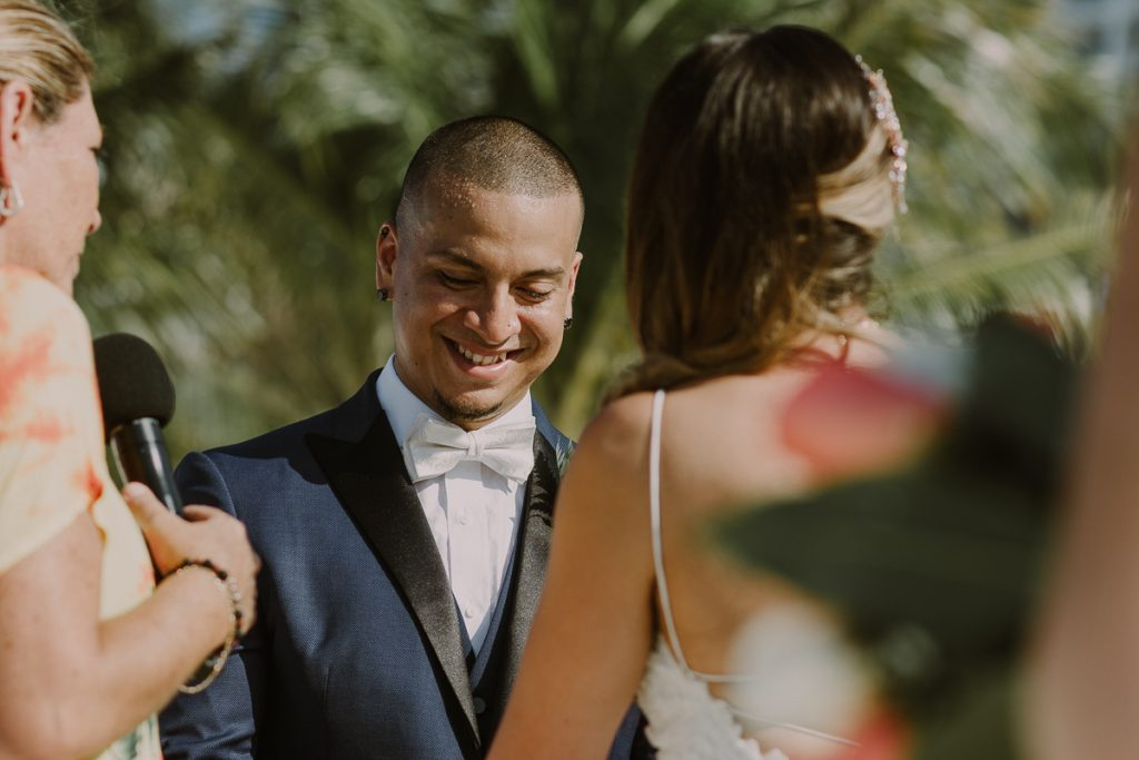 Groom at Riu Caribe Cancun beach wedding by Caro Navarro Photography