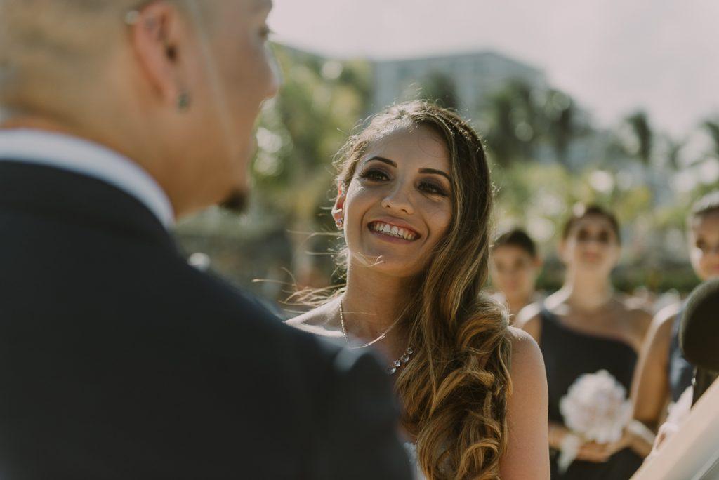 Bride smiling during Riu Caribe Cancun beach wedding by Caro Navarro Photography