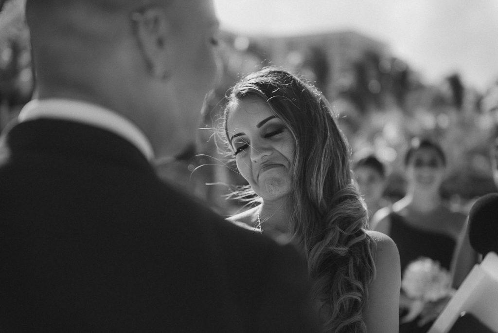 Black and white photo of bride at Riu Caribe Cancun beach wedding by Caro Navarro Photography
