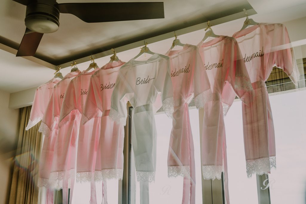 White and pink silk robes for bridal party. Royalton Riviera Cancun Wedding by Caro Navarro Photography