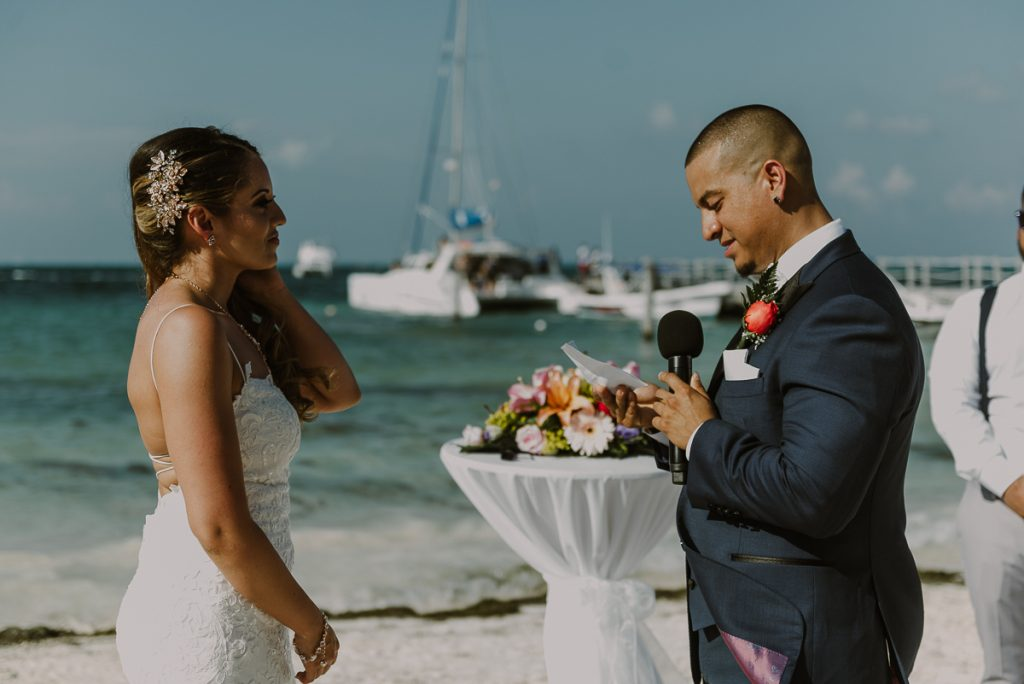 Vows moments during Riu Caribe Cancun beach destination wedding by Caro Navarro Photography