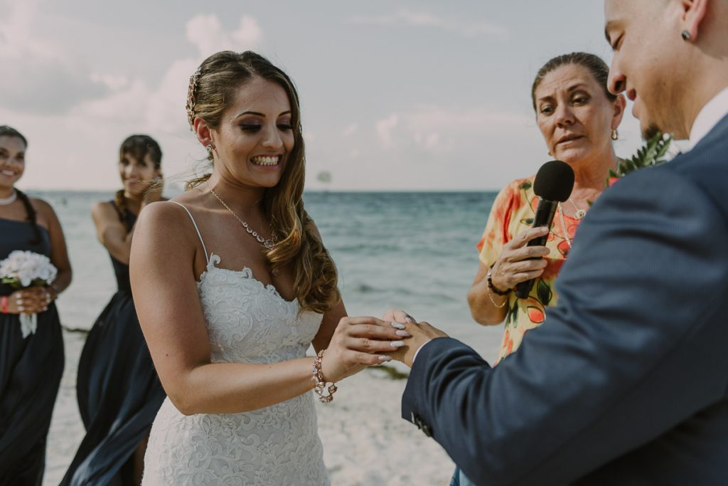 Ring exchange at Riu Caribe Cancun beach wedding by Caro Navarro Photography