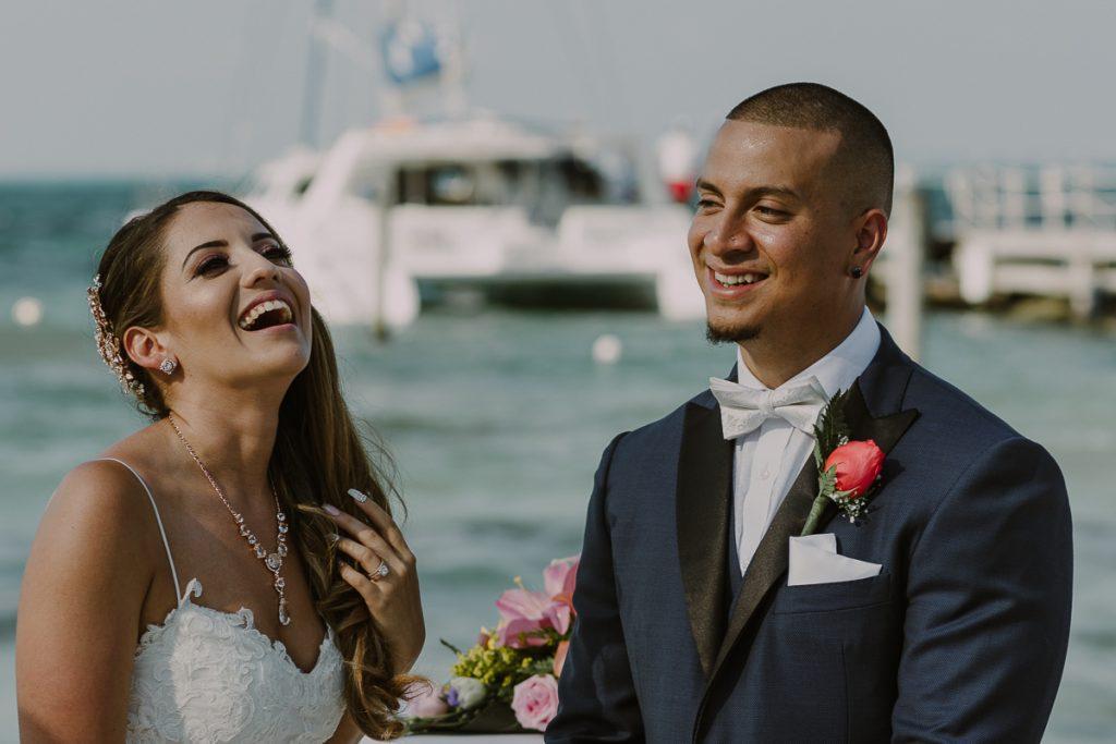 Happy bride and groom at Riu Caribe Cancun beach wedding by Caro Navarro Photography