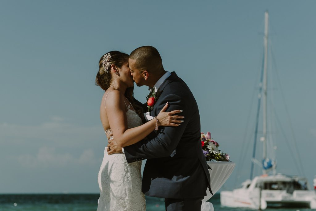 You may kiss the bride. Riu Caribe Cancun beach destination wedding by Caro Navarro Photography