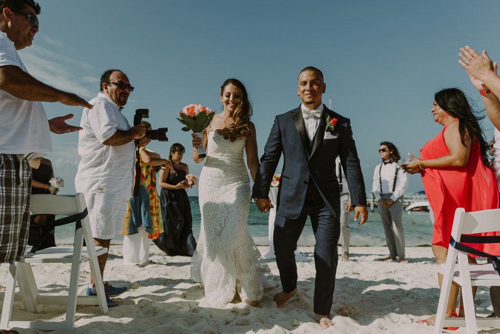 Bride and groom exit, Riu Caribe Cancun beach destination wedding by Caro Navarro Photography