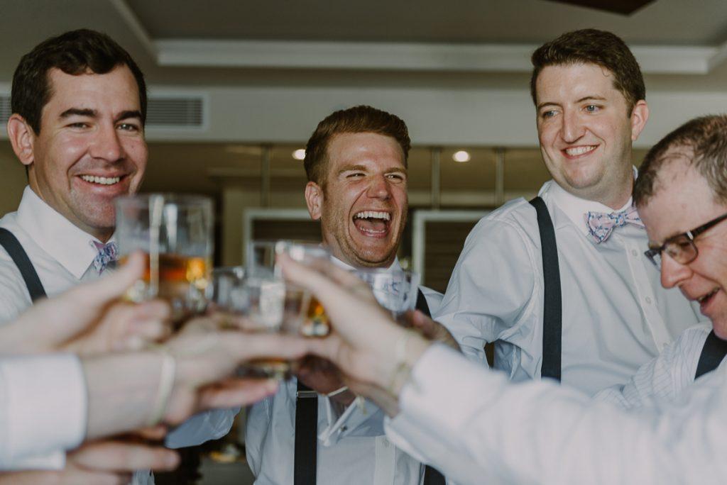 Groom and groomsmen pre-wedding toast at Royalton Riviera Cancun, Mexico. Caro Navarro Photography