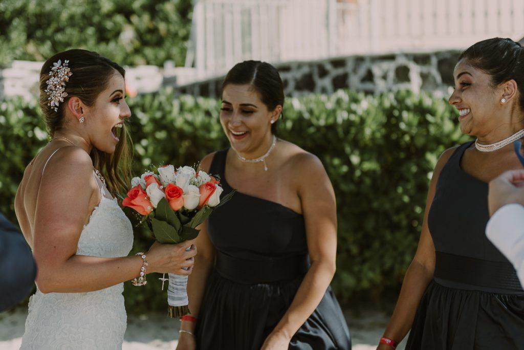Bride and bridesmaids at Riu Caribe Cancun beach wedding by Caro Navarro Photography