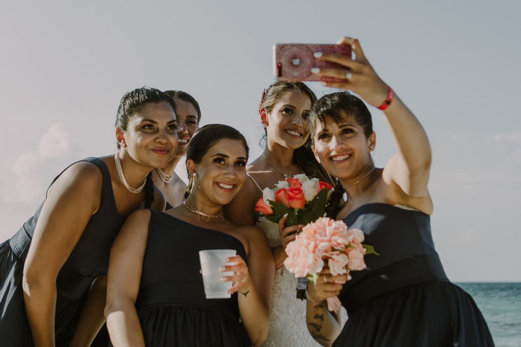 Bridal party selfie at Riu Caribe Cancun beach destination wedding by Caro Navarro Photography