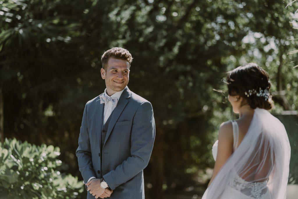 Bride and groom first look at Royalton Riviera Cancun Wedding. Caro Navarro Photography