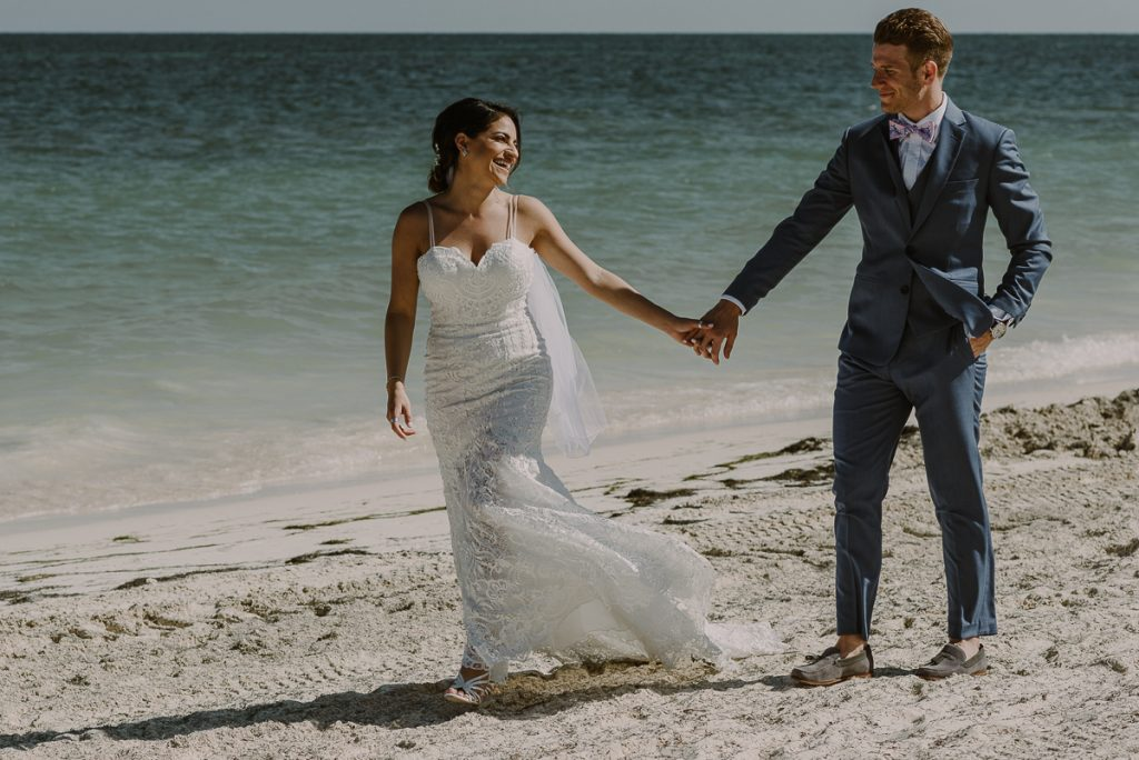 Beach bride and groom portraits by Caro Navarro Photography at Royalton Riviera Cancun