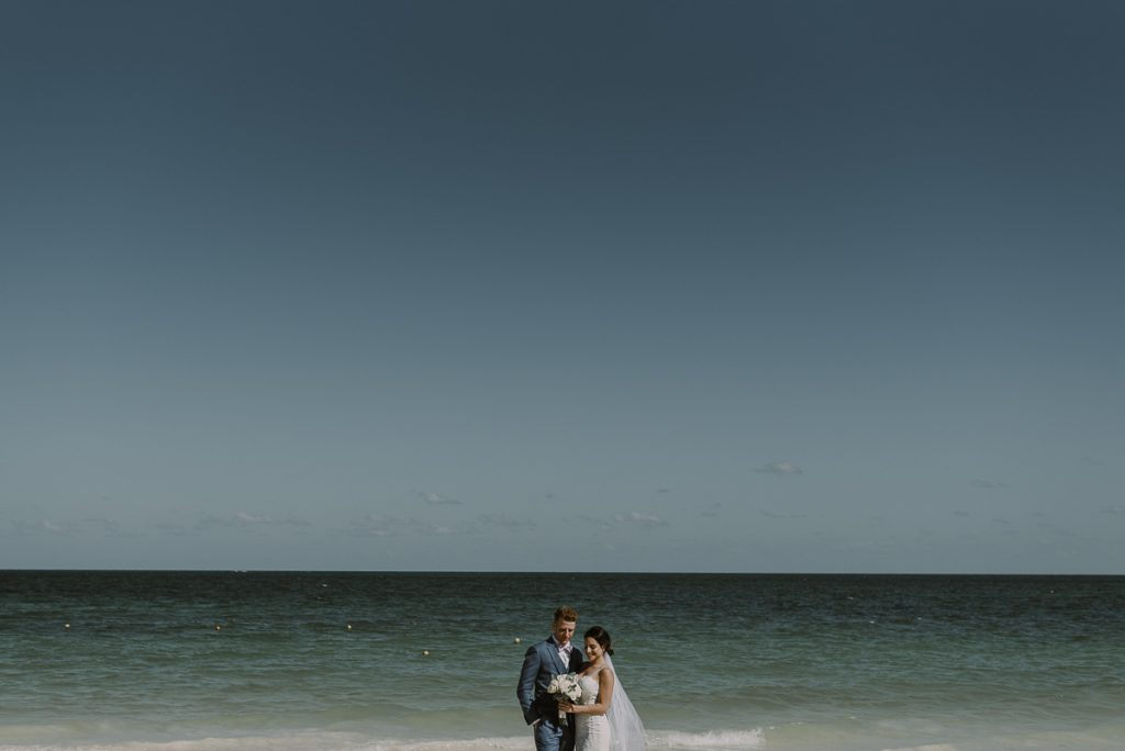 Bride and groom beach portraits. Royalton Riviera Cancun Wedding by Caro Navarro Photography