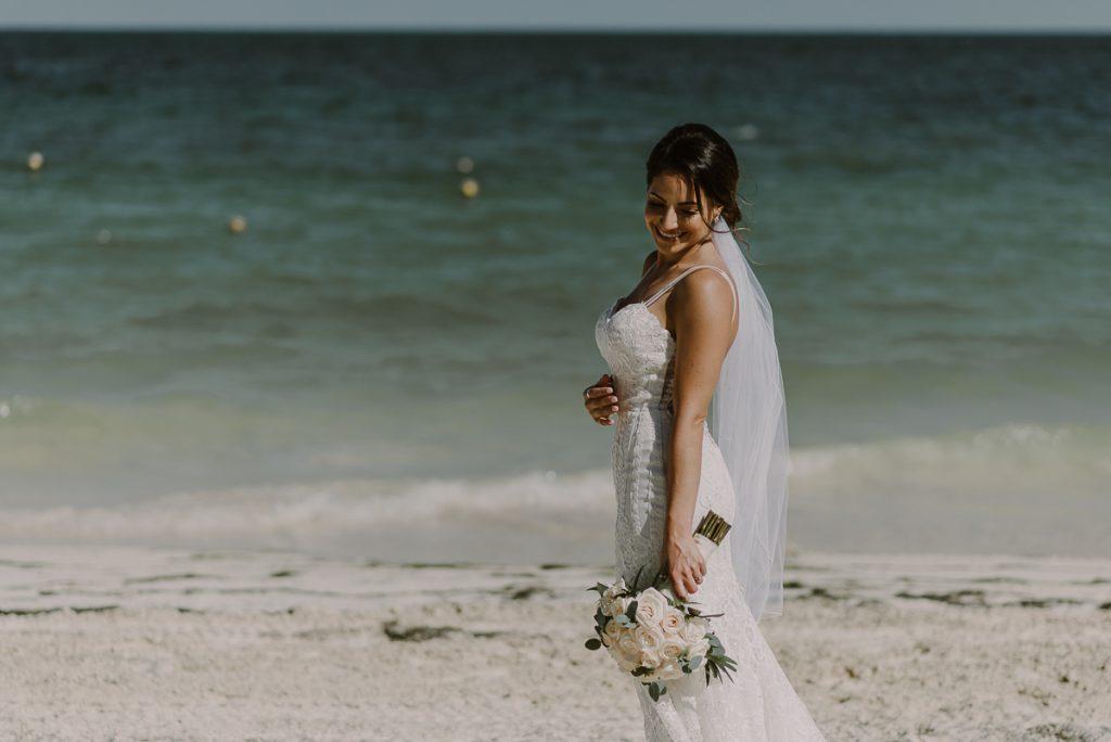 Destination beach bride at Royalton Riviera Cancun. Caro Navarro Wedding Photography