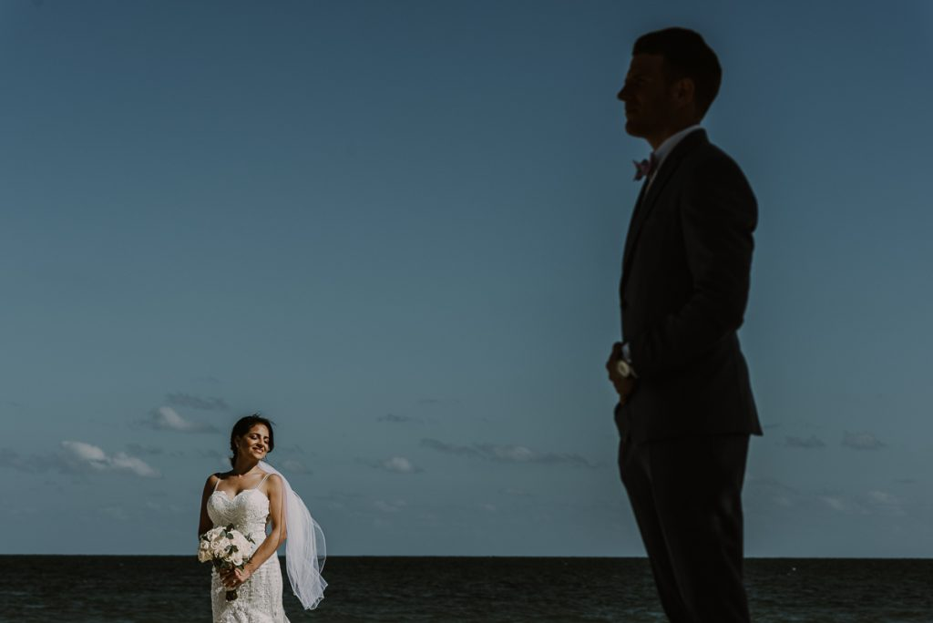 Creative bride and groom portraits by Caro Navarro Photography at Royalton Riviera Cancun