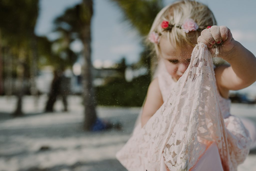 Flower girl in pink lace dress. Royalton Riviera Cancun Wedding by Caro Navarro Photography