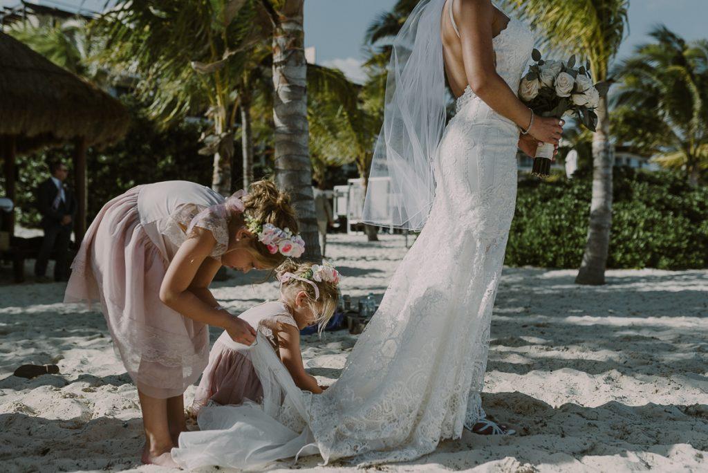 Flower girls helping bride. Royalton Riviera Cancun Beach Wedding by Caro Navarro Photography