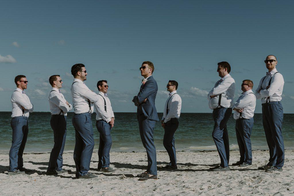 Groom and groomsmen beach portraits at Royalton Riviera Cancun, Mexico. Caro Navarro Wedding Photography