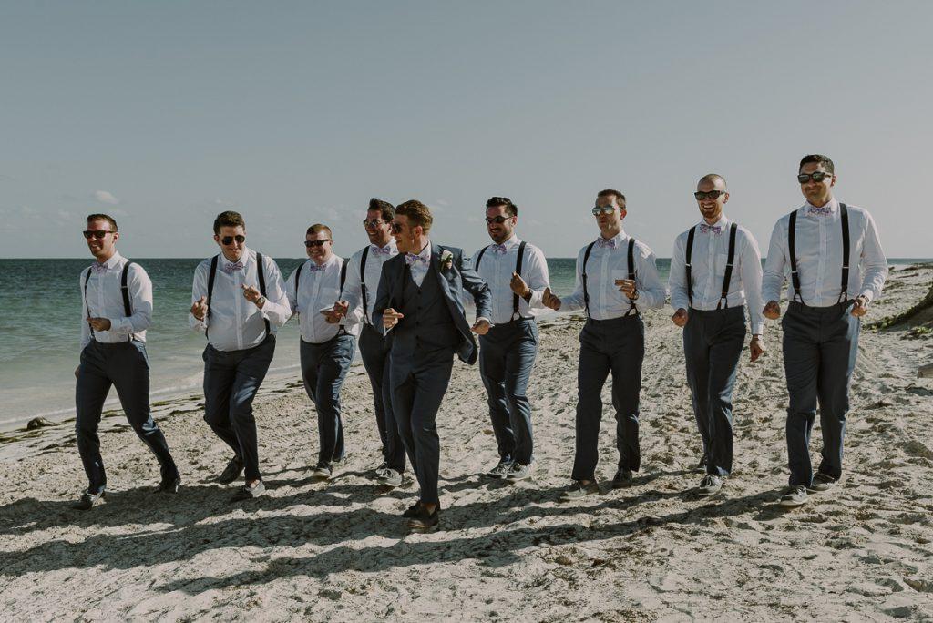 Groom and groomsmen beach portraits at Royalton Riviera Cancun, Mexico. Caro Navarro Photography